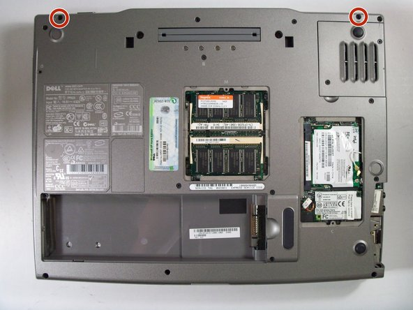 Flip the laptop over and remove the indicated screws.
