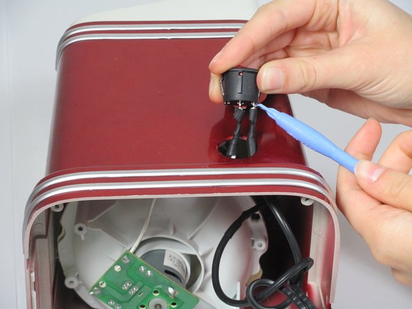 Image 1/1: Use the plastic opening tool to gently pry the wires loose from the power switch.