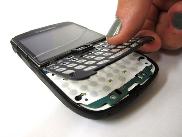 Carefully pull keyboard base up and away from phone.