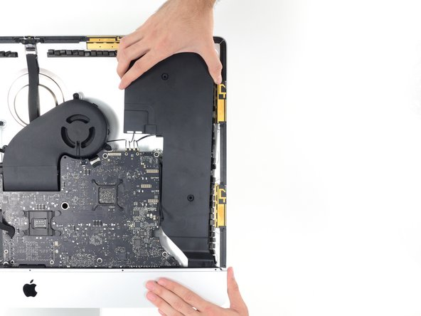 Lift the speaker straight up and remove it from the iMac.