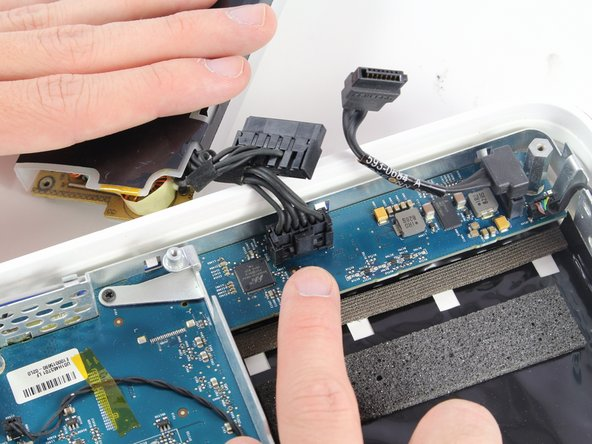 Disconnect the final power cable from the logic board.