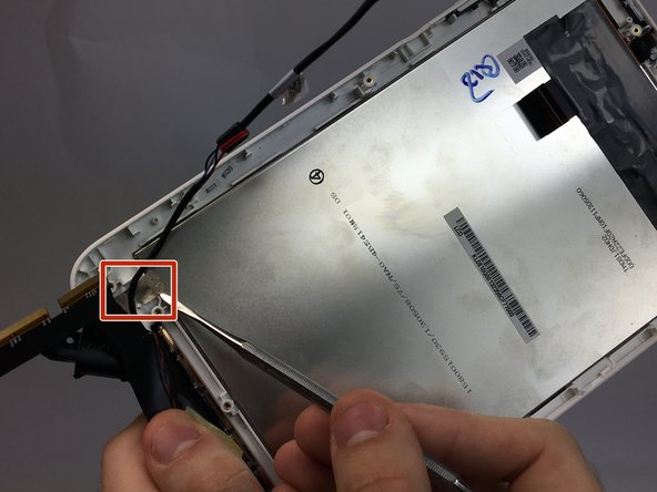 detach metal tape from the back of the screen using a spudger.