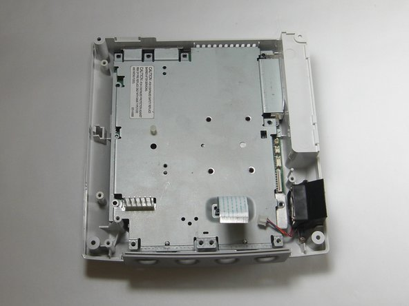 Remove the three black 12mm Philips #02 screws from the right side of the logic board cover.