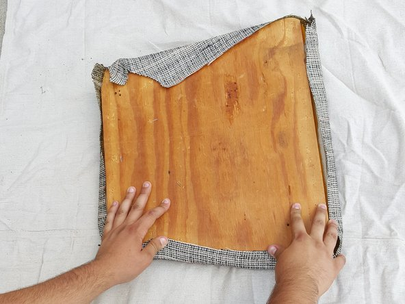 Fold the sides of the cover over the board and cushion keeping them as close to the center of the board as possible.