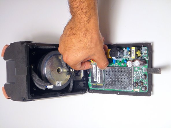 Using your fingers, detach and remove the communications board from the motherboard.