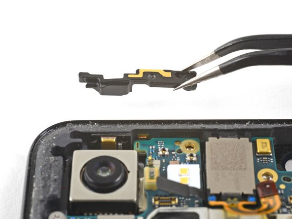 Carefully remove the antenna bracket from the top left edge of the phone.