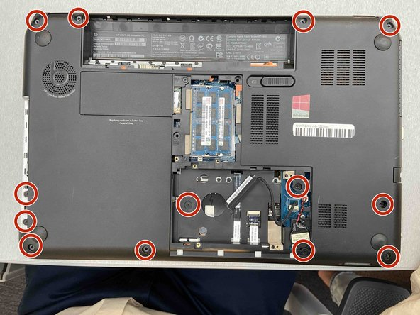 Remove the 13 screws on the bottom of the laptop using a Phillips #1 screwdriver.