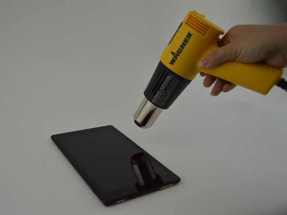 Heat the edges of the screen with a heat gun on the lowest setting by using sweeping motions from about 8-10 inches away.
