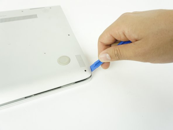 Remove the back case by using a plastic opening tool.
