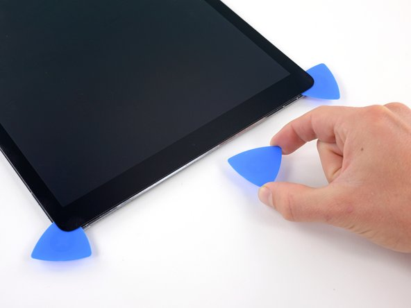 Remove the pick that was placed in the middle of the top edge of the iPad, next to the front-facing camera.