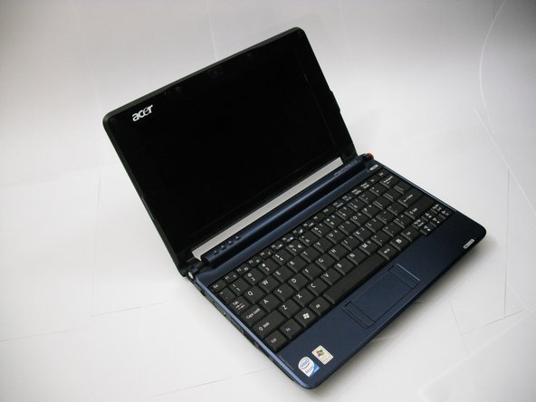 Turn the netbook over and open the display so that the keyboard is facing you.