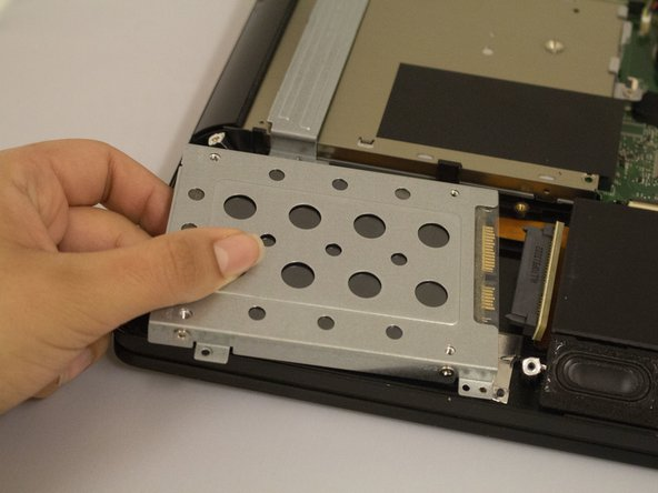 Gently disconnect the Hard Drive from the connector cable. Lift out to remove it.
