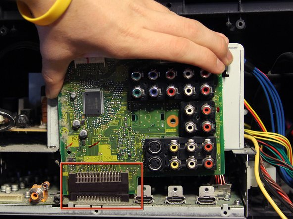 Disconnect the input/output board from the port in the main board by gently lifting upward and pull it out from the casing.