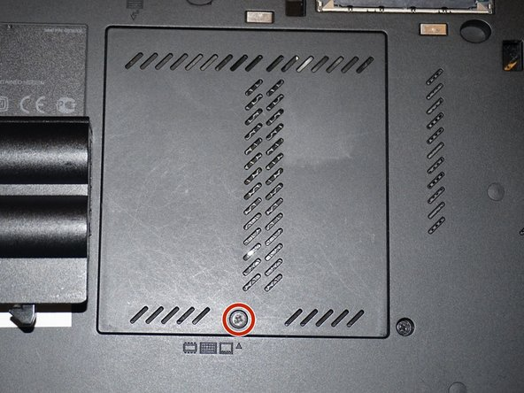 To remove the bottom memory module, open the memory door. To do this, use a Phillps #0 screwdriver.