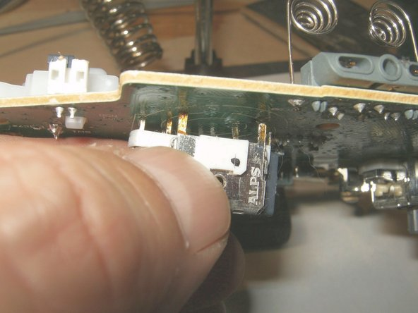 Image 3/3: If properly desoldered, the analog stick should clear the board without difficulty