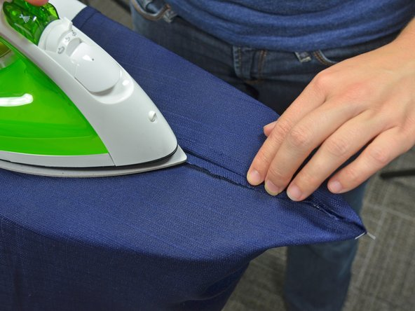 Image 2/3: Do not move the iron, simply let the iron sit on the seam for 10-30 seconds. Lift and repeat.