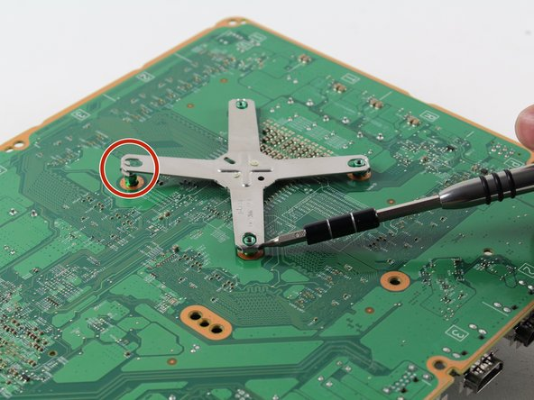 These photos show a screwdriver being used to lift the bracket corners. Use a spudger or plastic opening tool to prevent damage to the motherboard.
