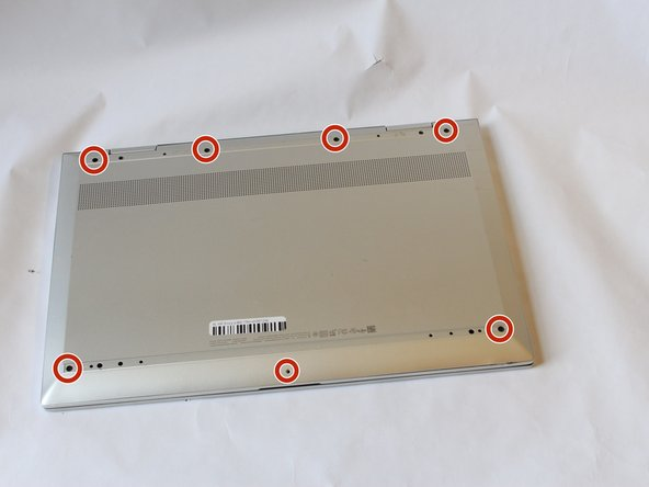 Using the Phillips #0 screwdriver, remove the seven 5mm screws from the back case.