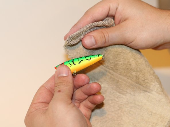 Wipe the freshly sanded lures with a wet cloth. Allow it to fully dry.