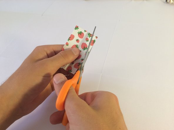 Use a pair of scissors to cut out a small strip of rolling paper.
