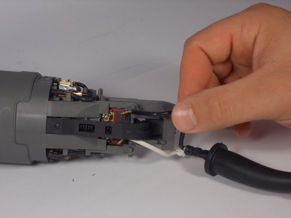 Careful remove each wire from the power cord from underneath the terminals.