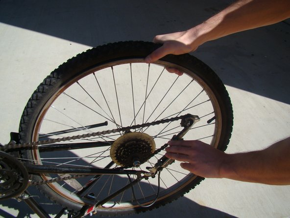 Pull the chain slack and remove the tire.