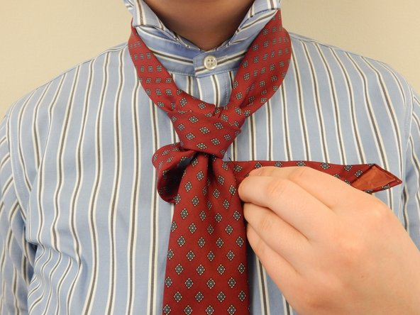 Wrap the active end under the wide tie to the right, so that the active end is pointing right.