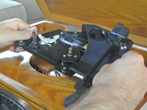 Image 1/2: Remove the three bushing bolts.