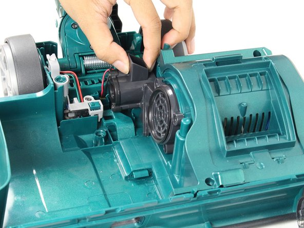 Remove the airpath grille from the side of the motor compartment by pulling out and away from the attached area.