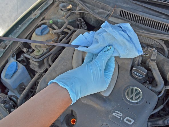 Wipe the dipstick down with a rag or towel to completely remove all oil so you can get a good read.