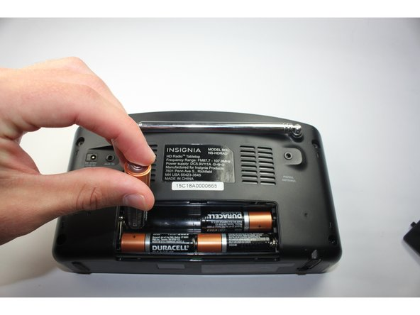 "The battery's positive terminal is indicated by a ""+"" on the side."