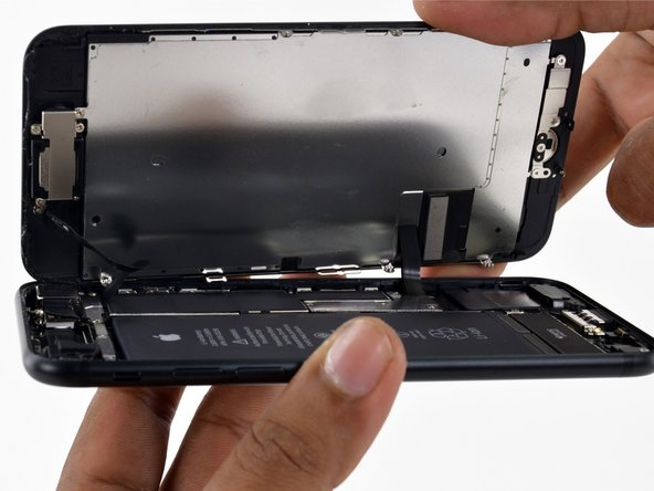 iPhone 7 being repaired with iFixit repair guides