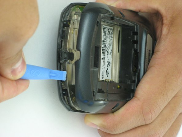 Image 2/2: Applying too much pressure could break the plastic clips and permanently damage the casing, so be careful.