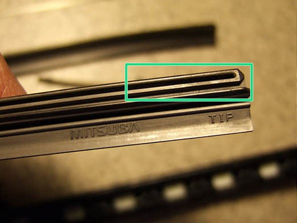 Image 1/3: The blade inserts have a groove or slot running the length that will take the metal or plastic reinforcement splines. (Your replacement inserts probably did not come with new splines. You'll reuse the ones in your current blades.)
