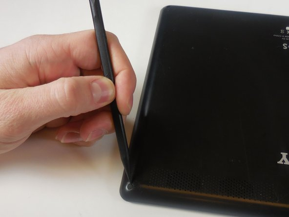 Use a spudger to remove the four rubber screw covers from the four back corners of the tablet.