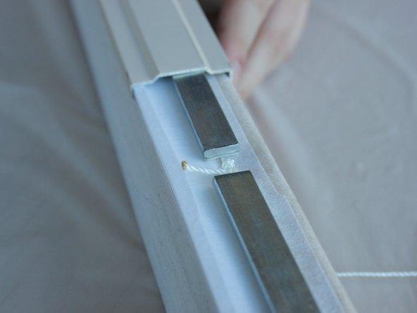 Slide the bottom rail off and set aside.