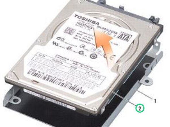 Place the NEW hard drive in the hard drive cage and press it down until it snaps into place.