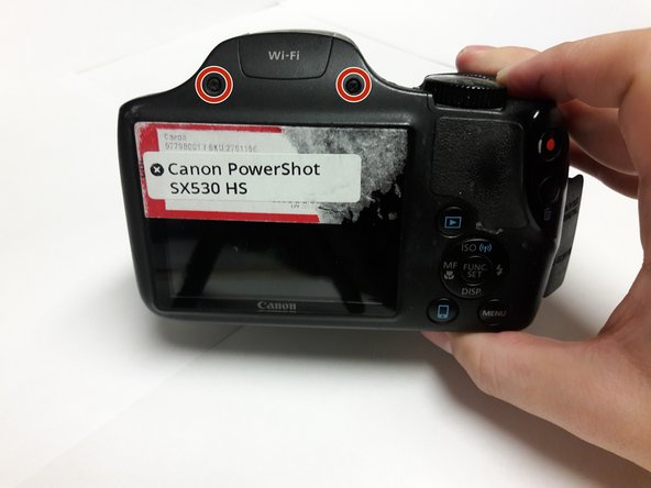 Rotate the camera to locate the side with the LCD screen.
