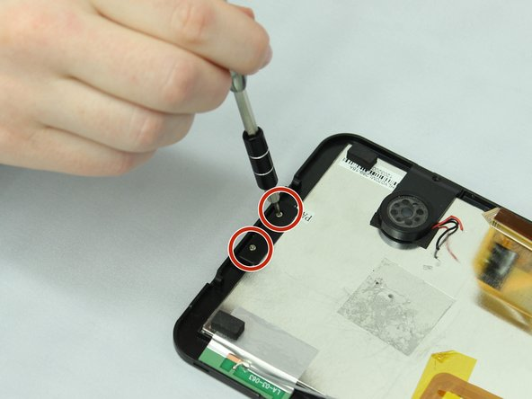 Using a J000 Philips head screwdriver, remove the two 5mm screws that hold the display unit down at the bottom of the device, turning the screws counterclockwise.
