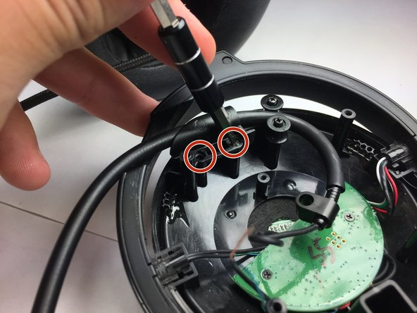 Rotate the screwdriver in a counterclockwise direction to remove each screw.