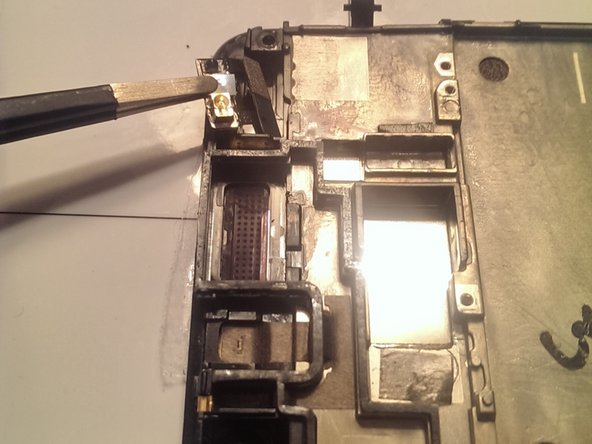 Remove the power button by Peeling away the small amount of tape holding it to the screen assembly.