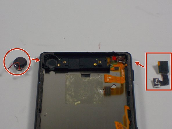 With the plastic covering gone, the front camera and signal receptor can be taken off the phone. You should use the prying spatula to remove these two items. Be careful with prying out the signal receptor because  it has adhesive tape underneath.