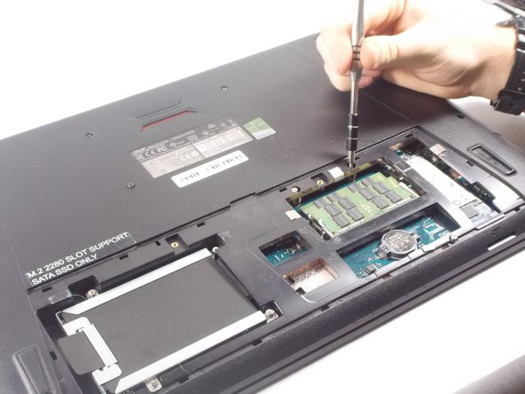 Remove all screws located under the panel as seen in the ram replacement guide. (8 in total)