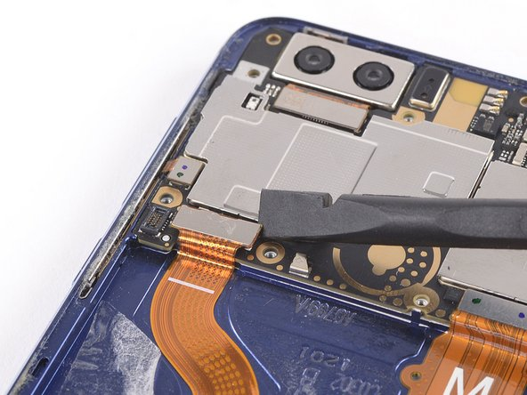 Use a spudger to pry up and disconnect the display flex cable from its motherboard socket.