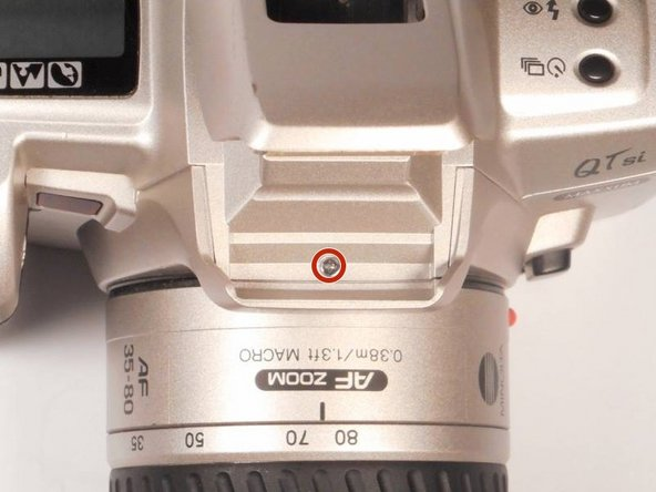 When looking at the top of the camera, the flash hood is visible.