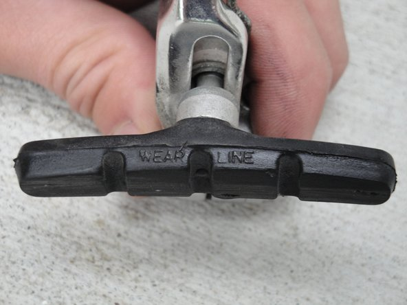"Inspect the brake pad. If the pad has worn down past the ""wear line"", then it needs to be replaced."