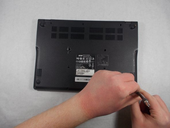 Unscrew the thirteen 6.0mm screws on the back panel using your JIS 1 screwdriver.