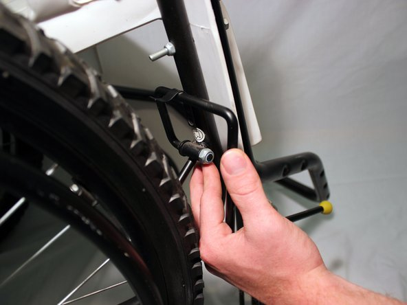 Image 1/2: Repeat with the brake on the other side of the wheelchair.