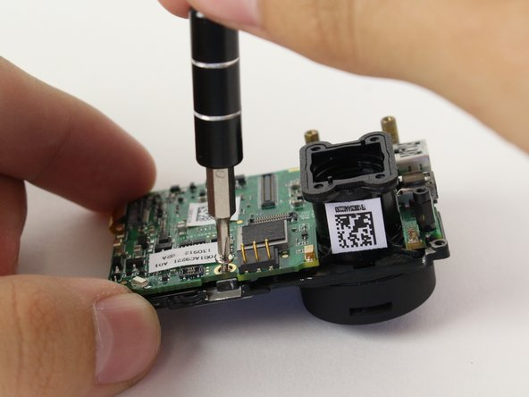 Image 1/3: Separate the LCD assembly by pulling away the motherboard.