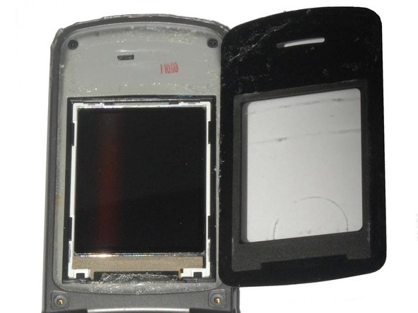 The screen cover is adhered to the phone and may take some effort to pry off. If it is too difficult to remove, heat the screen with a hair dryer on low for 30 seconds to soften the adhesive.